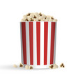 popcorn in striped red and white bucket vector image