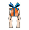 hand holds gift box present wrapped ribbon bow vector image