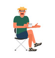 resting man sitting on a folding chair in a t vector image