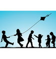 Group of children silhouettes with a kite outdoor vector image vector image