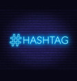 neon hashtag sign on brick wall background vector image