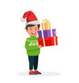 happy boy in christmas hat with a gift for a vector image