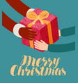 christmas greeting card santa claus gives a gift vector image