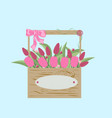 bouquet of tulips in a wooden box vector image