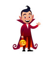 funny cartoon little vampire boy wearing halloween vector image