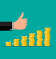stack gold coins and hand with thumb up gesture vector image