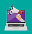 hand holding megaphone coming out from laptop vector image vector image