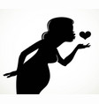 black silhouette of a beautiful pregnant woman vector image