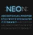 Realistic neon alphabet glowing font vector image vector image