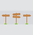 wooden arrows pointers with bushes grass vector image