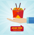 hand giving box with wok noodles asian food vector image vector image