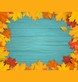 fallen leaves on turquoise wooden background vector image vector image