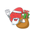 santa bowling ball character cartoon with gift vector image vector image