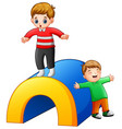 two boys playing in the playground vector image vector image