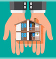 businessman holding house building vector image