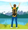 Young male hiker enjoying mountain lake
