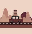 car with luggage on top rides on the highway vector image