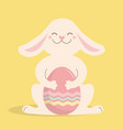 easter rabbit and egg cute bunny hold vector image vector image