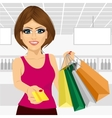 young woman holding shopping bags vector image vector image
