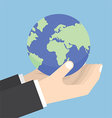 Businessman hands holding the world vector image