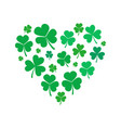 heart made of small shamrock or clover vector image vector image