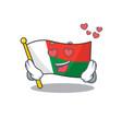 cartoon on mascot flag madagascar in love vector image vector image
