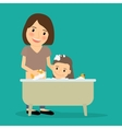 Mother bathing baby girl vector image