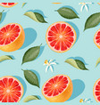 Seamless pattern with grapefruit slices and leaves
