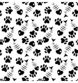 seamless paw and fish pattern vector image