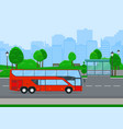 red shuttle bus going on country road vector image vector image