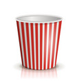 an empty red-and-white striped bucket of popcorn vector image