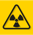 danger radioactive sign on yellow background vector image vector image