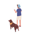 guy stand hold ball training or playing with dog vector image vector image