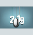 2019 new year and rugby ball hanging on strings vector image vector image