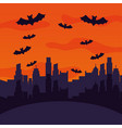 halloween city with bats flying scene vector image