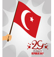 turkey republic day hand holding flag in pole vector image vector image