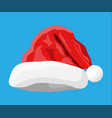 Red santa claus hat isolated on blue background