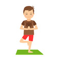 young boy standing in yoga pose vector image vector image