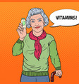 pop art senior happy woman with pills health care vector image vector image