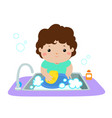 happy boy washing dish on white background vector image vector image