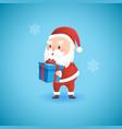 christmas funny santa claus holding gift box vector image vector image