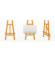 realistic wooden easel with white canvas vector image vector image
