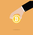 businessman hand holding bitcoin vector image vector image