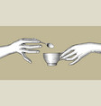 female hands with a cup coffee and a small vector image