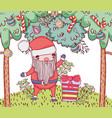santa claus with present and pine trees vector image vector image