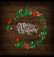christmas calligraphy with hand drawn wreath vector image