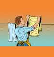 vintage employee hangs up to dry clothes vector image vector image