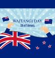 waitangi day hand holds a new zealand flag vector image vector image
