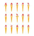 icons golden torch with flame isolated set vector image