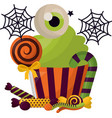 halloween sweet cupcake with eye and candies vector image